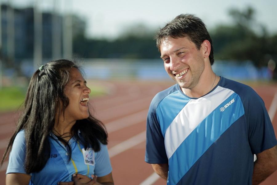 Yanina Martinez con su entrenador